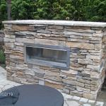 This exterior linear fireplace is built into a concrete surround, supported by a concrete footing, and then dressed with cultured stone